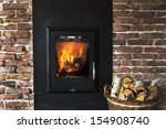 Fireplace In A Brick Wall And...