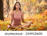 beautiful young girl meditating ... | Shutterstock . vector #154910600