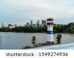 Lighthouse With City In The...