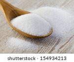 sugar on wooden table.... | Shutterstock . vector #154934213
