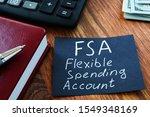 Text sign showing hand written words FSA flexible spending account
