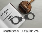 Judge's Gavel  Handcuffs And...