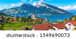 Aerial panoramic view of Spiez town with Church and Castle on the shore of Lake Thun in the Swiss canton of Bern at sunset, Spiez, Switzerland. - stock photo