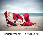 Santa Claus Relaxes Lying On...