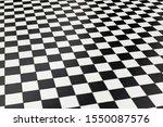 Checkered black and white floor tiles at a public station in perspective. Shottenring Ubahn, Vienna, Austria
