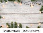 christmas lights bulb and pine...   Shutterstock . vector #1550196896