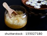 body scrub and bowl with flowers   Shutterstock . vector #155027180