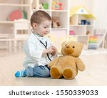 Child Boy Playing Doctor And...