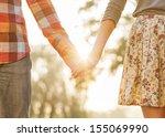 young couple in love walking in ... | Shutterstock . vector #155069990
