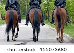 Three horses with equestrians...