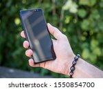 black modern smartphone in hand   Shutterstock . vector #1550854700