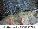 Foots Standing On The Rock Near ...