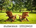 Two Wooden Adirondack Chairs O...