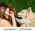 Stock photo beautiful young happy laugh girl playing with her dog outdoor 155129660