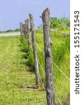 A Row Of Wooden Fence Posts And ...