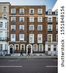 Small photo of LONDON, UK - 22 OCTOBER 2019: Traditional Georgian townhouses in the affluent Kensington and Chelsea district.