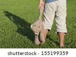 young child holding a much... | Shutterstock . vector #155199359