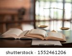 Law Books And Scales Of Justic...