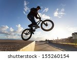 young man performs stunts... | Shutterstock . vector #155260154