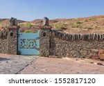 Blue Gate In Stone Wall Lookin...