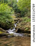 Small photo of Long exposure of the West Lyn river flowing through the woods at Glen Lyn gorge at Lynmouth in Devon