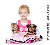 Little Girl Hugging A Kitten...