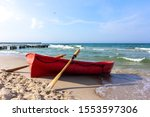 A Lifeboat On A Beach In Summer