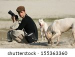 Photographer With His Dogs On...