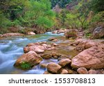 Small photo of Smooth water flow and rocks in Neda river, Peloponnese, Greece. Beautiful colorful landscape
