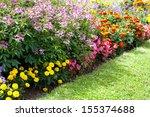 Various Flowers Growing In...