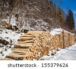 Pile Of Firewood. Snowy...
