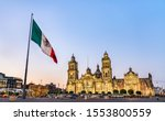 Small photo of Flagpole and the Metropolitan Cathedral of the Assumption of Virgin Mary in Mexico City, the capital of Mexico