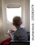 Little Boy Sitting Inside The...