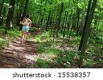 mature woman running in forest. | Shutterstock . vector #15538357