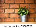 A Tree Pot Against Orange Bric...