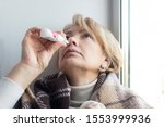 sick ill senior mature woman... | Shutterstock . vector #1553999936