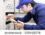 portrait of an electrician at... | Shutterstock . vector #155418278