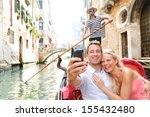 Couple In Venice On Gondola...