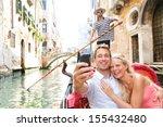 couple in venice on gondola... | Shutterstock . vector #155432480