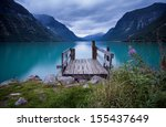 wooden dock at norwegian lake  - stock photo