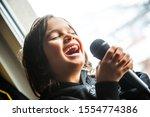 Boy Singing At Home Alone
