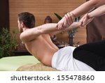 thai woman making massage to a... | Shutterstock . vector #155478860