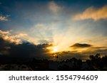 Sunbeams Streak from Clouds at Sunrise