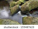 flowing water through rocks | Shutterstock . vector #155487623