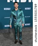 "Small photo of Westwood- NOV 05: Nick Jonas arrives for the ""Midway"" Los Angeles Premiere. on November 05 2019 in Westwood, CA"