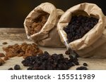 golden and black raisins in... | Shutterstock . vector #155511989