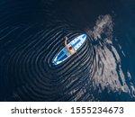 Man Rowing Oar On Sup Board...