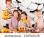 family on halloween party with... | Shutterstock . vector #155533178