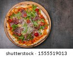 delicious fresh pizza on table   Shutterstock . vector #1555519013