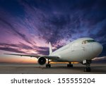 commercial airplane with sunset | Shutterstock . vector #155555204